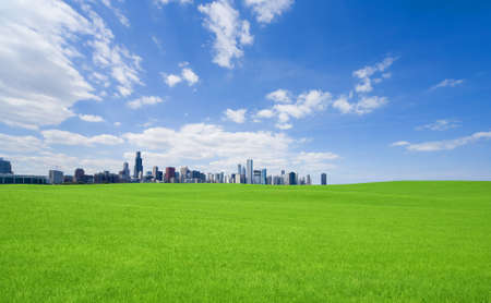 Green grass and  downtown Stock Photo