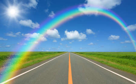 Rainbow over straight road photo