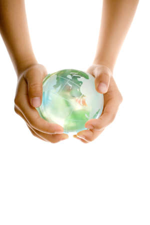 Child holding a globe in hands. photo