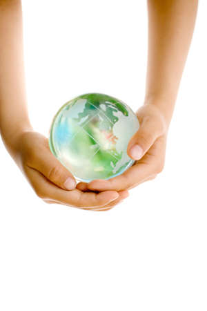 Child holding a globe in hands photo