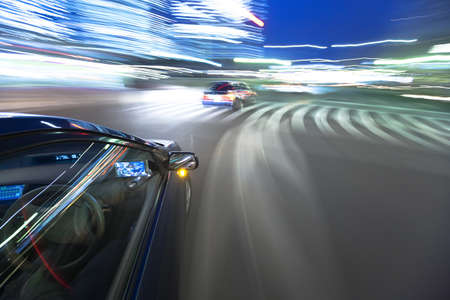 The car moves at great speed at the evening photo