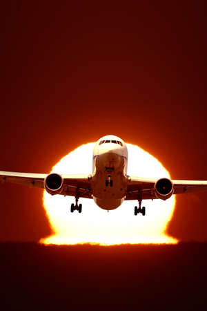 An airplane flying in the sun photo