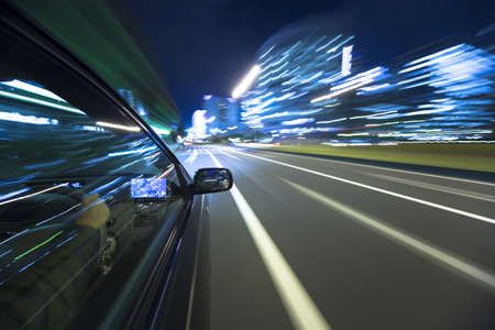 The car moves at great speed at the night Stock Photo - 9480097