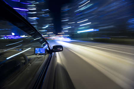 The car moves at great speed at the night Stock Photo