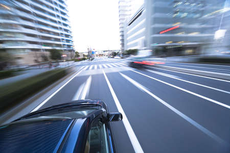 The car moves at great speed at the evening