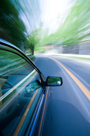 moves: The car moves at great speed at the sunny day.
