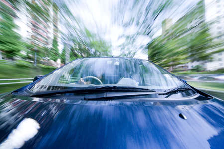 fast lane: The car moves at great speed during the day Stock Photo