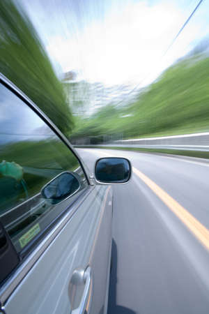 The car moves at great speed at the sunny day. Stock Photo - 9479274