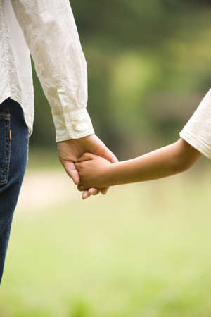 Hands of mother and son Stock Photo