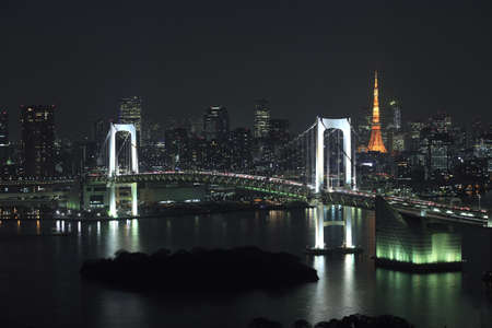 tokyo tower: View of Tokyo downtown at night with Rainbow Bridge