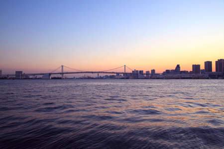 View of sunset Tokyo bay with Rainbow Bridge. photo