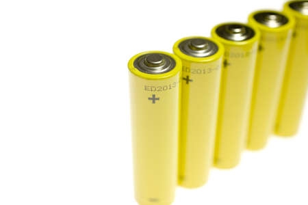 consumable: Gold battery in upright position with focus to the positive terminal at the top Stock Photo
