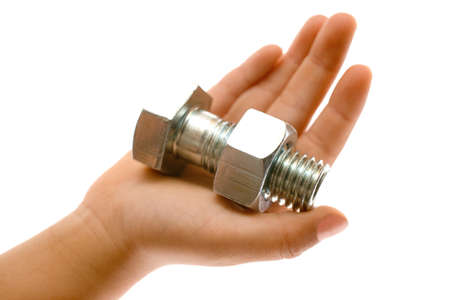 Hand holding a large silver metal bolt and nut over a white background Stock Photo - 12595276