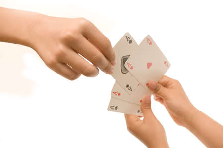 Picking one of four aces held by two hands on white Stock Photo - 12595432
