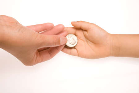 Handing a coin to someone on white background photo