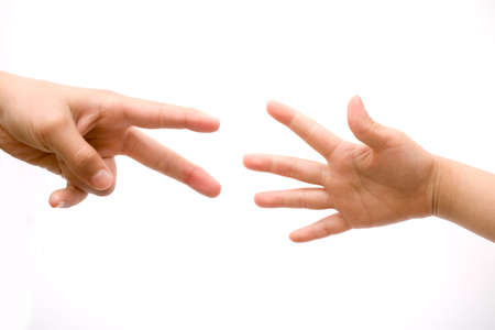 imploring: Two human hands stretching out towards one another over a white background in a concept of help and assistance Stock Photo