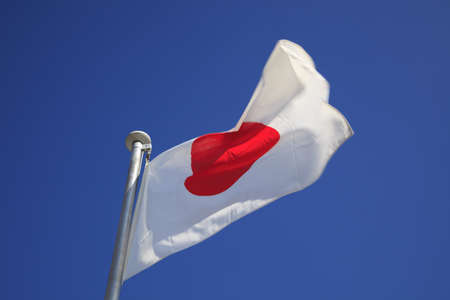 Closeup of a Japanese flag with blue sky  photo