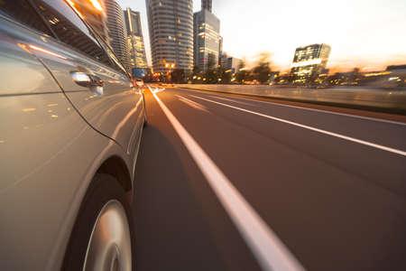 Driving in the sunset city. Standard-Bild