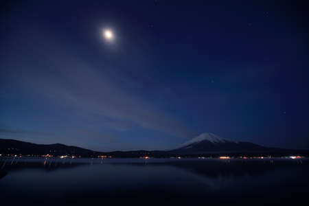 Mount Fuji and Lake Yamanaka at night. photo