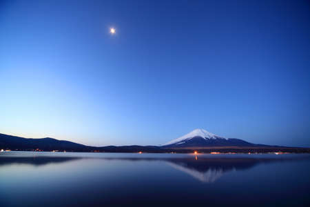 Mount Fuji and Lake Yamanaka at night. Stock Photo