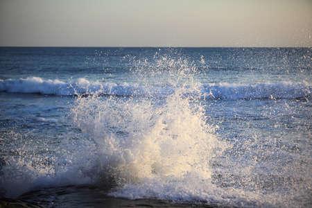 Big sea wave on a windy day photo