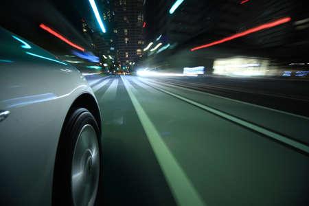 Driving in the night city Standard-Bild