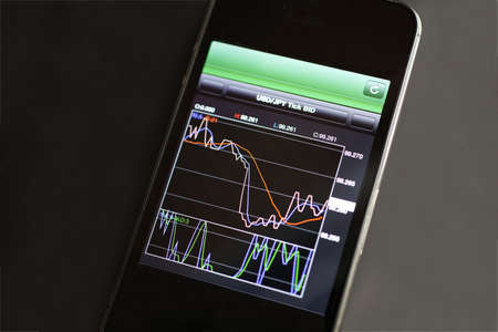 Foreign exchange market chart at smart phone Stock Photo - 19364344