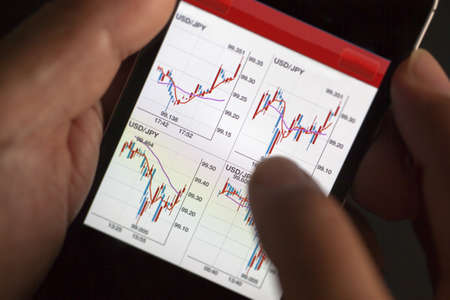 Foreign exchange market chart at smart phone Stock Photo - 19364345