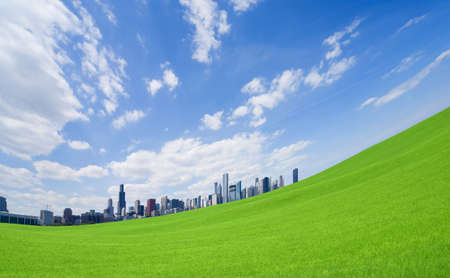 blue sky: Green grass and  downtown Stock Photo
