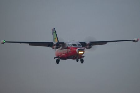 chopin: Warsaw, POLAND - December 22, 2016: Let 410 Turbolet landing on Warsaw Chopin airport.