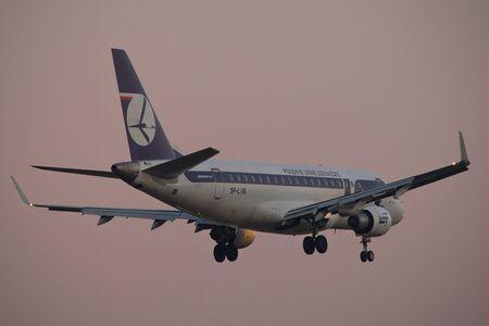 warsaw chopin: Warsaw, POLAND - December 22, 2016: Embraer 175 of LOT Polish Airlines landing on Warsaw Chopin airport. Editorial