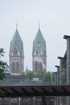 Herz-Jesu-Kirche in freiburg in a hazey mist Editorial