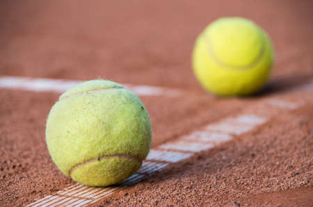 Close up of two tennis balls on the court Stock Photo