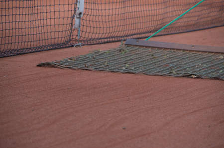 Clean sweeping a tennis court