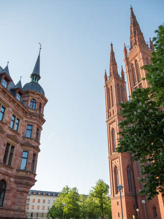 Marktkirche in Wiesbaden on a summers afternoon with a plane flying through in the background 写真素材