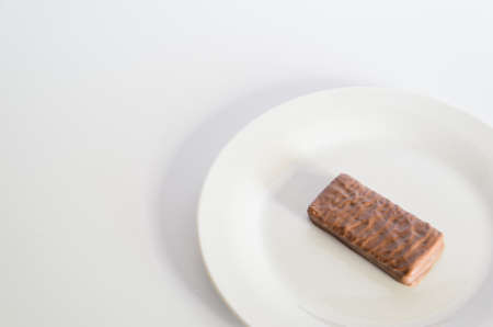 Iconic Australian chocolate biscuit on a white plate