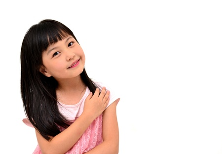 asian child: happy little girl on white background