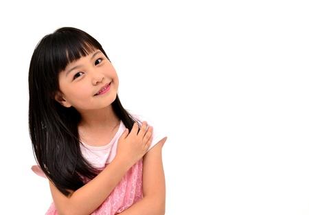 ni�os chinos: ni�a feliz sobre fondo blanco Foto de archivo