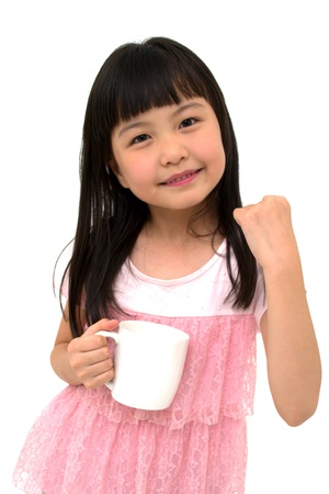 Poweful Little Asian Girl with Cup, isolated on white background
