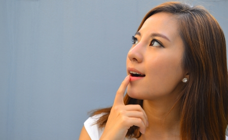 Beautiful young asian woman thinking  Stock Photo