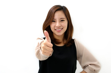 Success woman thumbs up
