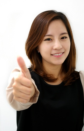 Success woman thumbs up photo