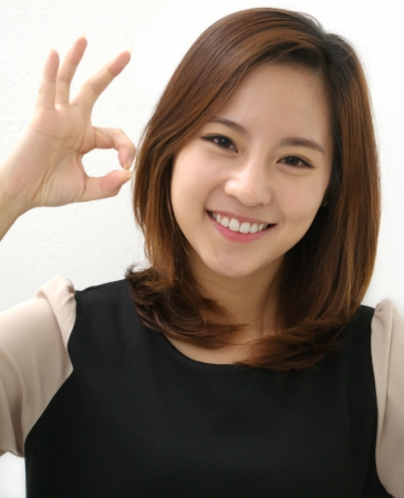 Beautiful female giving okay sign photo
