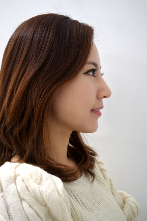 Side view, close-up, beauty shot of a smiling photo