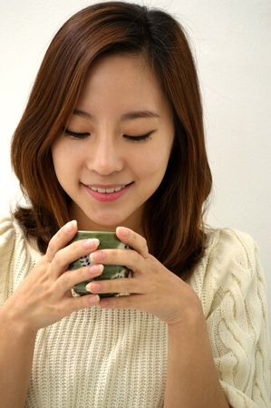 Woman drinking tea photo