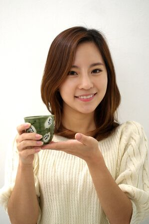Happy woman drinking tea photo