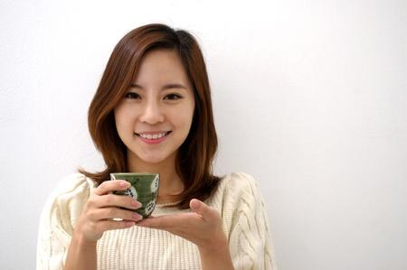 Happy woman drinking tea