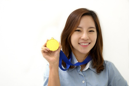 Young Businesswoman holds up her gold medal photo