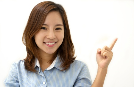 Close-up of a young woman pointing Stock Photo - 17347654