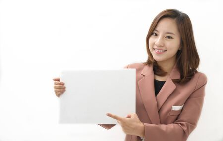 commentator: Young Woman Holding a Blank White Sign Stock Photo